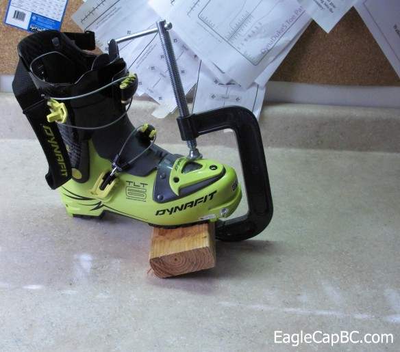 Heated boot with a C clamp. Block of wood underneath to prevent any warping of the sole.