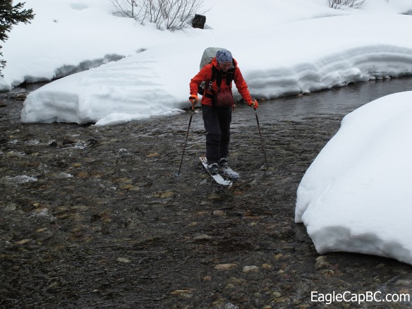 Emily fording a river. Ski gear is made to get wet. Right?